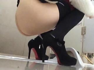 YourVoyeurVideos  Woman in high heels caught in public toilet pissing PaysiteRip VoyeurXXX PORN RIP